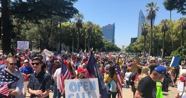 Protestors call for Governor Gavin Newsom to reopen California at a rally at the state capitol, May 1, 2020