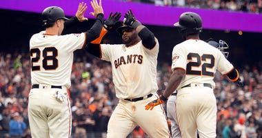 Apr 4, 2018; San Francisco, CA, USA; San Francisco Giants Pablo Sandoval, center, celebrates his three-run home run with teammates Buster Posey (28) and Andrew McCutcheon (22) in the fifth inning of a baseball game against the Seattle Mariners at AT&T