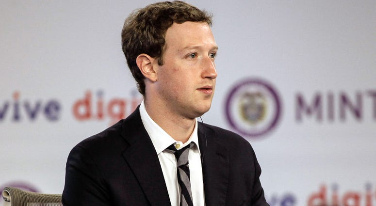 Manuel Santos at Narino House in Bogota, capital of Colombia, on Jan. 14, 2015. Colombian President Juan Manuel Santos Wednesday met with Facebook founder Mark Zuckerberg in Bogota to discuss plans to bring Internet service to the masses.