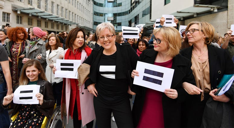 3/8/2018 - Journalist Carrie Gracie (centre) and BBC employees gather outside Broadcasting House in London, to highlight equal pay on International Women's Day. (Photo by PA Images/Sipa USA) *** US Rights Only ***