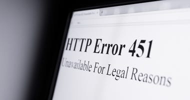 Net Neutrality, HTTP error 451 Unavailable For Legal Reasons - Shining computer screen in dark space - censorship and blocking internet pages because of objectionable content. Possibility of misuse (lack of freedom)