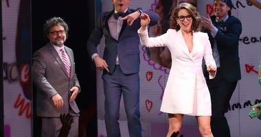 "Jeff Richmond, left, and Tina Fey participate in the curtain call for the ""Mean Girls"""