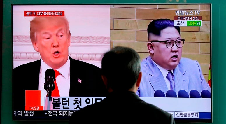 FILE - In this March 27, 2018, file photo, a man watches a TV screen showing file footages of U.S. President Donald Trump, left, and North Korean leader Kim Jong Un during a news program at the Seoul Railway Station in Seoul, South Korea. A Trump administ
