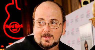 "FILE - In this Nov. 10, 2014 file photo, James Toback, screenwriter of the original ""The Gambler"" and executive producer of the new re-make arrives at the premiere of the film at AFI Fest 2014 in Los Angeles. Los Angeles prosecutors are declining to bring"