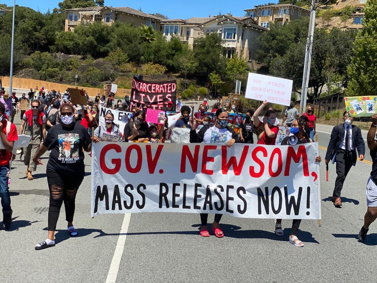 Protestors march to San Quentin calling for the mass release of prisoners.