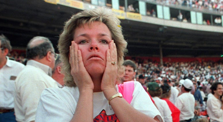 At Candlestick Park, the World Series was suddenly forgotten. A fan reacts to the shaking at the park in October 1989 just after the Loma Prieta earthquake.