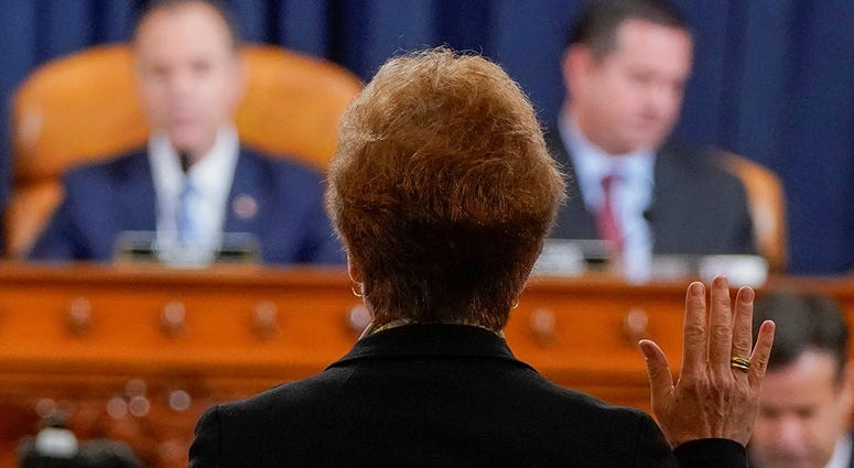 Marie Yovanovitch, former U.S. ambassador to Ukraine, is sworn in before a House Intelligence Committee hearing as part of the impeachment inquiry into U.S. President Donald Trump on Capitol Hill in Washington, U.S., November 15, 2019.