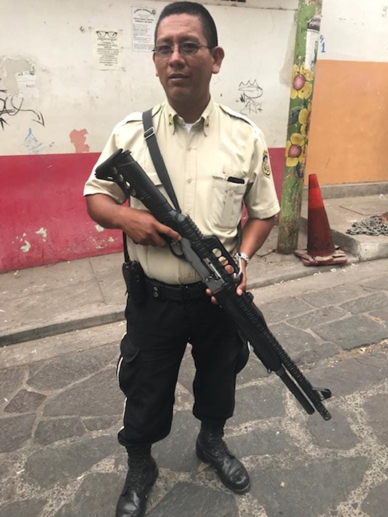 An armed soldier patrols the streets in Panchimalco, El Salvador