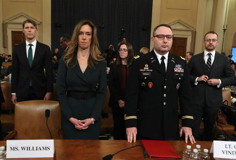ennifer Williams, adviser to Vice President Mike Pence for European and Russian affairs, and National Security Council Director for European Affairs Lt. Col. Alexander Vindman arrive to testify before the House Intelligence Committee on Nov. 19, 2019.