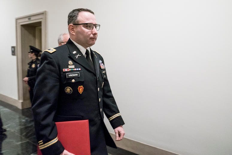 Lt. Col. Alexander Vindman, National Security Council Director for European Affairs, walks through the halls of the Longworth House Office Building on Nov. 19, 2019.