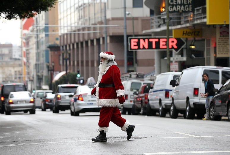 A man dressed as Santa Claus walks down Geary Street on December 14, 2012 in San Francisco.