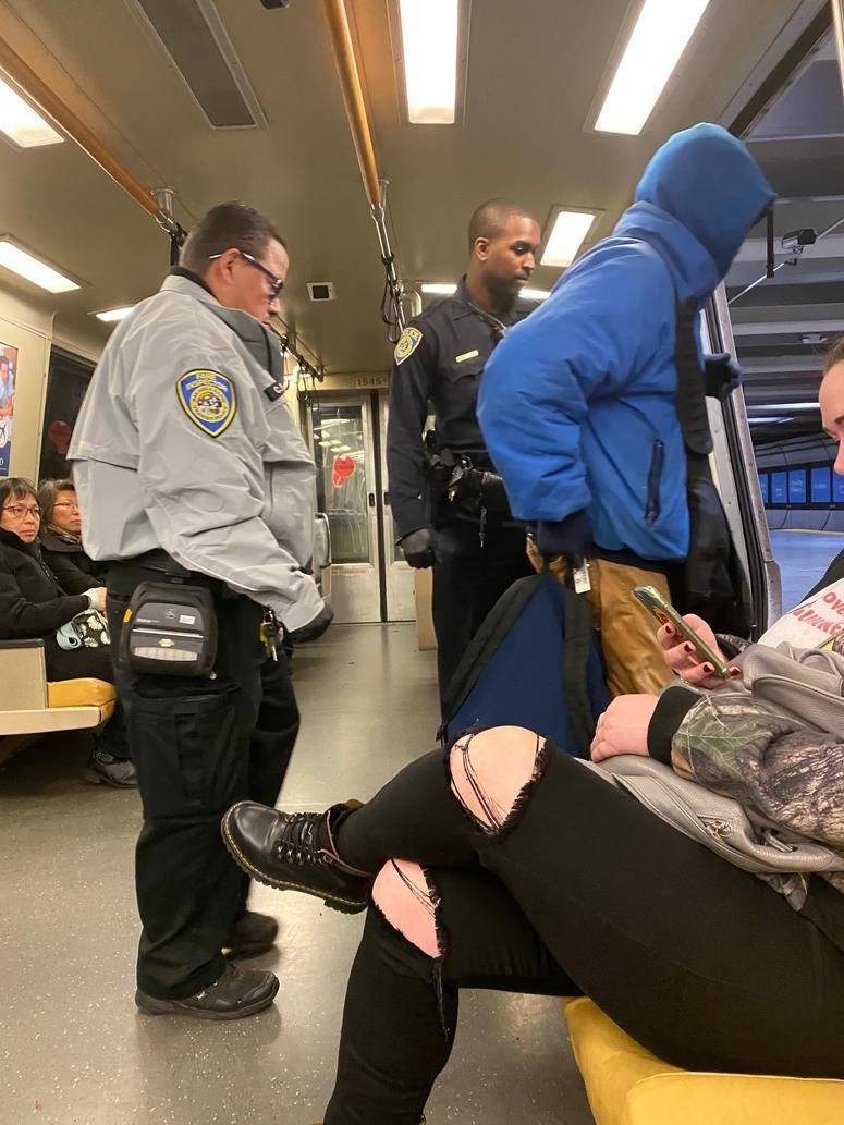 BART rider escorted from train by fare inspector and BART Police officer