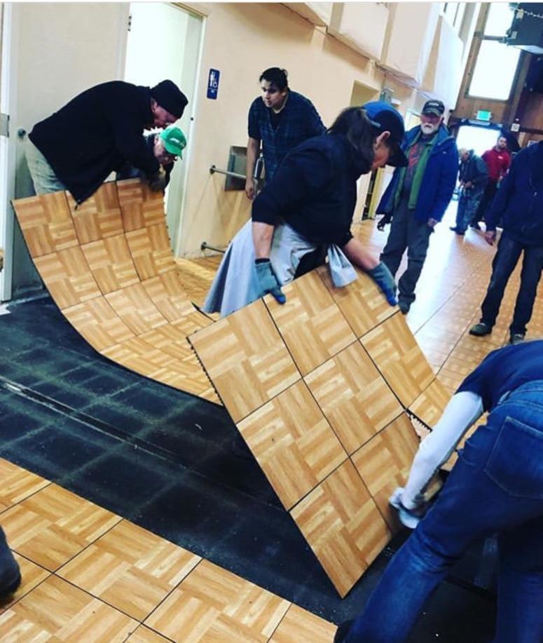 Volunteers remove dance floor at Sebastopol Community Cultural Center
