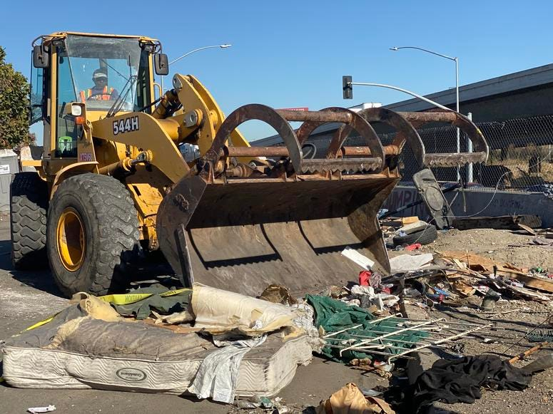 Oakland workers clean up homeless camp near Fruitvale Home Depot