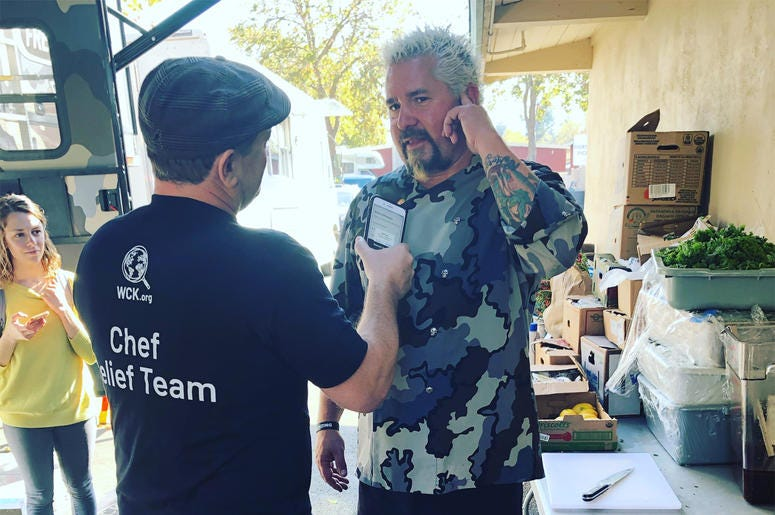 Liam talking to Guy Fieri at World Central Kitchen in Santa Rosa (Photo credit: Foodie Chap/Liam Mayclem)