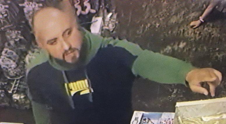 A Concord shopkeeper released surveillance images of two adults who allegedly distracted him while a child stole a Legos set.