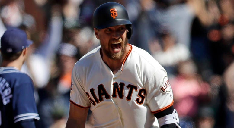 San Francisco Giants' Hunter Pence, center, celebrates after his bases-loaded walk-off double against the San Diego Padres during the eleventh inning of a baseball game Sunday, June 24, 2018, in San Francisco. San Francisco won 3-2.