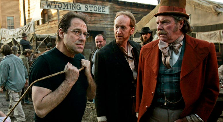 """In this Feb. 9, 2005 file photo, David Milch, left, creator of the HBO series """"Deadwood,"""" appears on the set with Larry Cedar, center, and Peter Jason in Santa Clarita, Calif. HBO says it's greenlighted a long-discussed movie based on the Western drama th"""