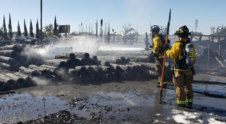 Firefighters extinguish flames that destroyed the Piedmont Lumber Company in Pittsburg on June 23, 2019.