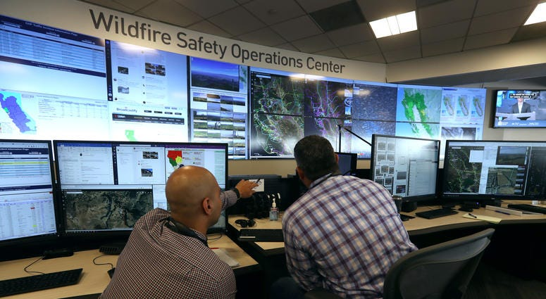 nalysts at the Pacific Gas and Electric (PG&E) Wildfire Safety Operations Center monitor a wildfire on August 05, 2019 in San Francisco, California.
