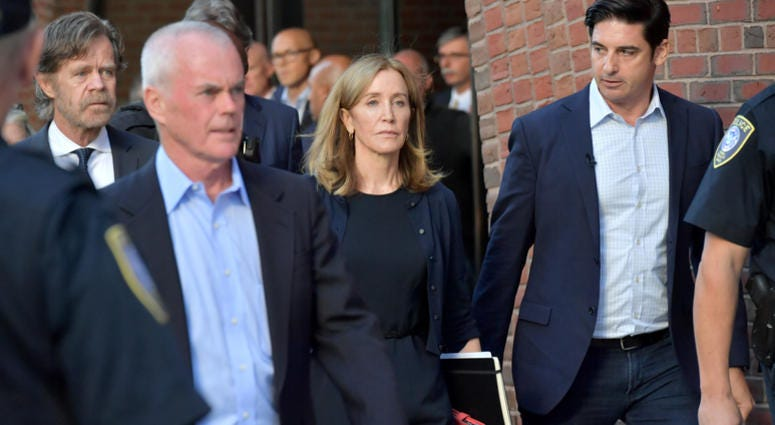 Felicity Huffman and husband William Macy exit John Moakley U.S. Courthouse where Huffman received a 14 day sentence for her role in the college admissions scandal on September 13, 2019 in Boston, Massachusetts.