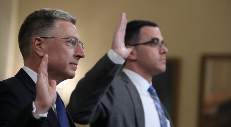 Former State Department special envoy to Ukraine Kurt Volker (L) and former National Security Council Senior Director for European and Russian Affairs Tim Morrison are sworn in before testifying to the House Intelligence Committee on Nov. 19, 2019.