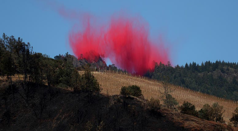 ire retardant lingers in the air after being dropped by a plane ahead of the Kincade Fire on October 29, 2019 in Healdsburg.