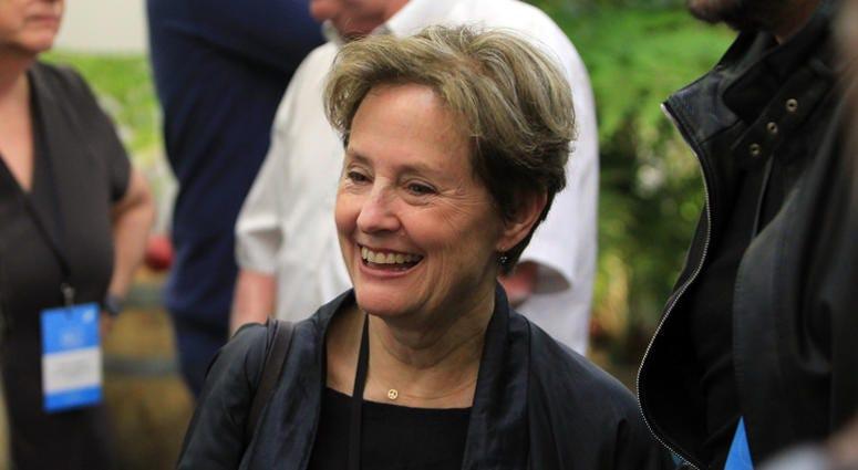 : Alice Waters smiles in the Virgin Australia Domestic Lounge at Hobart International Airport on November 13, 2014 in Hobart, Australia.