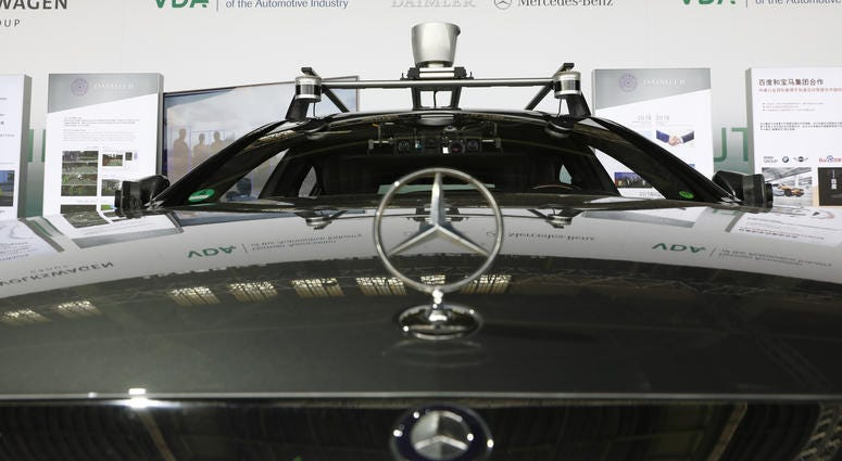 Cameras and gps navigation system gear are placed on a self driving Mercedes car on display at an event to present a project on autonomous driving at former Tempelhof airport on July 10, 2018 in Berlin.