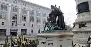 This March 2, 2018 file photo shows a statue that depicts a Native American at the feet of a Spanish cowboy and Catholic missionary in San Francisco. San Francisco authorities reversed a decision to remove a 19th century statue near City Hall that some sa