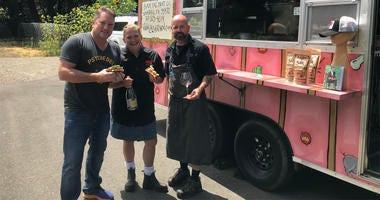 "Liam with Chefs John Stewart & Duskie Estes of ""The Black Piglet"" food truck"