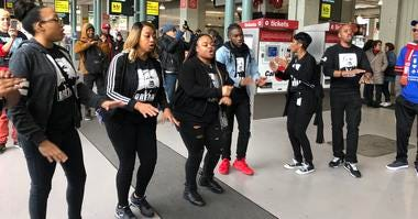 Singers that rode the Celebration Trade, which took riders from the South Bay to San Francisco to attend the MLK Day march, serenade the crowd at 4th Street CalTrain station in San Francisco on Monday, 20th, 2020.