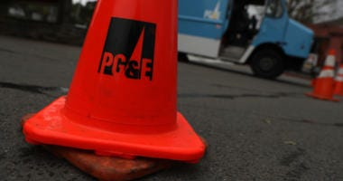 A traffic cone sits next to a Pacific Gas & Electric (PG&E) truck on January 17, 2019 in Fairfax, California.