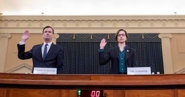 Laura Cooper, the deputy assistant secretary of defense for Russia, Ukraine, and Eurasia; and David Hale (L), the under secretary of state for political affairs, are sworn in prior to testifying before the House Intelligence Committee on Nov. 20, 2019.