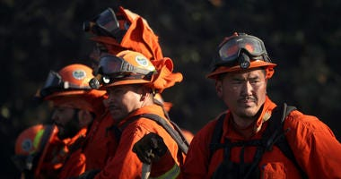 9: Inmate firefighters take a break while battling the Kincade Fire on October 29, 2019 in Healdsburg.