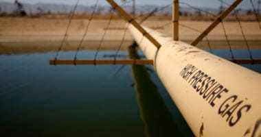 : A high pressure gas line crosses over a canal in an oil field over the Monterey Shale formation where gas and oil extraction using hydraulic fracturing, or fracking, is on the verge of a boom on March 23, 2014 near Lost Hills, California.