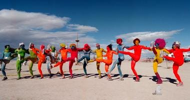 """e """"Painted People"""" of San Francisco and New York, dance while wearing only paint for clothing September 2, 2000 at the15th annual Burning Man festival in the Black Rock Desert near Gerlach, Nevada."""