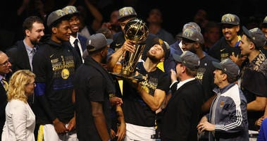 : Stephen Curry #30 of the Golden State Warriors celebrates with the Larry O'Brien Trophy after defeating the Cleveland Cavaliers during Game Four of the 2018 NBA Finals at Quicken Loans Arena on June 8, 2018 in Cleveland, Ohio.