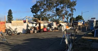 A homeless encampment near a Home Depot in Oakland on July 23, 2019.
