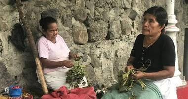 Salvadoran Women Eke Out A Living By Selling Fruit In The Mayan Town Of Panchimalco