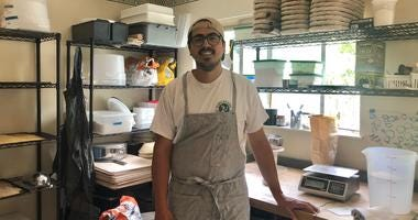 Lucio Meja at his Oakland Bread Studio home kitchen where he bakes bread to deliver.