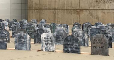 Homeless tombstones are on display at San Jose City Hall.