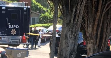 A crime scene technician is in front of a San Jose home where police say four people were killed by a gunman who also took his own life on June 23, 2019.