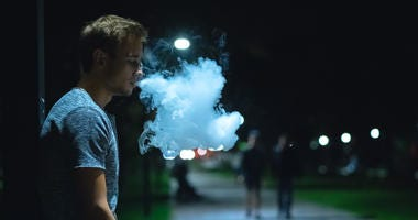 Vape smoker at night