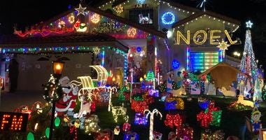 Alex Dourov, the creator of CaliforniaChristmasLights.com, puts up an elaborate holiday display at his Livermore home.