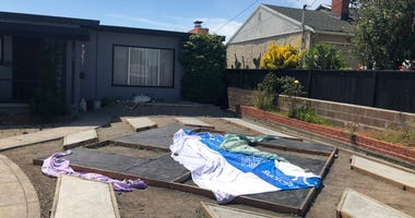 A swastika constructed in the front yard of an El Sobrante home is partially covered on June 13, 2019.