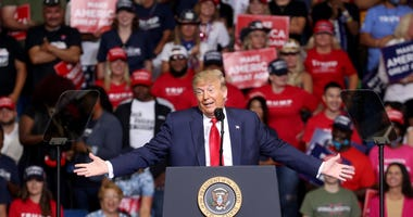 President Trump says he asked staffers to slow COVID-19 testing down at a rally in Tulsa, OK