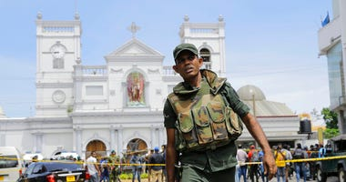 Sri Lankan Army soldiers secure the area around St. Anthony's Shrine after a blast in Colombo, Sri Lanka, Sunday, April 21, 2019. Witnesses are reporting two explosions have hit two churches in Sri Lanka on Easter Sunday, causing casualties among worshipp