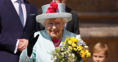 Britain's Queen Elizabeth II waves to the public as she leaves after attending the Easter Mattins Service at St. George's Chapel, at Windsor Castle in England Sunday, April 21, 2019. (