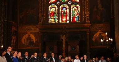 Faithfuls attend a Sunday Mass at the grandiose Saint-Eustache church on the Right Bank of the Seine river in Paris, Sunday, April 21, 2019. The archbishop of Paris and Catholics from around France and the world honored the firefighters who saved Notre Da